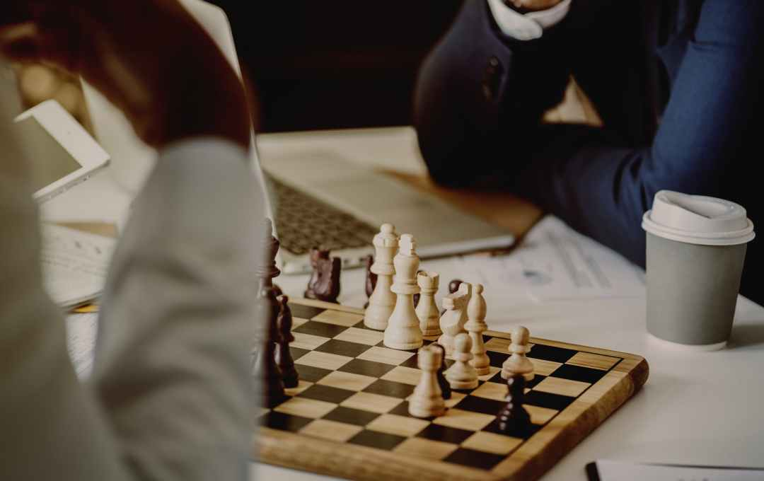 person playing chessboard set